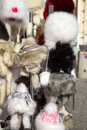 Furry hats exposed for sale in the market Stock Photo