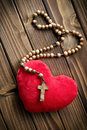 Furry heart with rosary beads top view of Royalty Free Stock Photos