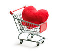 Furry heart in shopping cart on white background Stock Photo