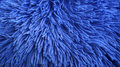 Furry Shaggy piece of a pillow cover in shinny navy blue color Royalty Free Stock Photo