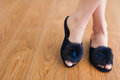 Furry slippers female feet with decor Royalty Free Stock Photos