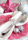 Fuschia pink christmas table setting with baubles and star Royalty Free Stock Image