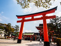 Fushimi inari shrine kyoto japan apr big torii gate of with blue sky on apr in the became the object of imperial Royalty Free Stock Images