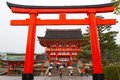 Fushimi inari shrine kyoto japan march a giant torii gate in front of the romon gate at s entrance on march in this is Royalty Free Stock Photo