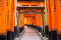 Fushimi inari shrine kyoto japan march on march in thousands of torii gates straddle a network of trails a walking Royalty Free Stock Image