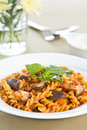 Fusilli with mushroom in tomato sauce Royalty Free Stock Photography