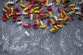 Fusilli pasta on grey stone table top view copyspace
