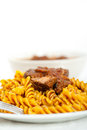 Fusilli pasta with neapolitan style ragu meat sauce al dente very different from bolognese Royalty Free Stock Image
