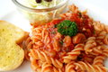 Fusilli tomato sauce with garlic bread Royalty Free Stock Photography