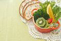 Fusion food fruit and vegetable salad in colorful cup with whole wheat bread Stock Photography