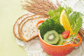 Fusion food fruit and vegetable salad in colorful cup with whole wheat bread Stock Images