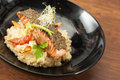 Fusion food white wine lemon sage risotto and sundried tomato with cured salmon tapenade european Stock Photo