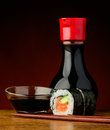 Futomaki sushi roll and soy sauce still life with chopsticks Royalty Free Stock Photos