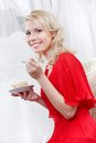 Future bride eats a delicious cake on white background Royalty Free Stock Images