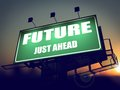 Future just ahead on green billboard the rising sun background Stock Photo