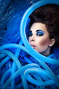 Futuristic beautiful young female face with blue fashion make up photo Royalty Free Stock Images