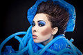 Futuristic beautiful young female face with blue fashion make up photo Stock Image