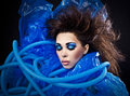 Futuristic beautiful young female face with blue fashion make up photo Stock Photography
