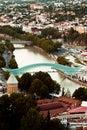 Futuristic Bridge of Peace and old buildings in Tbilisi, Georgia Royalty Free Stock Photo