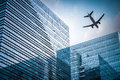 Futuristic building with airplane Royalty Free Stock Photo