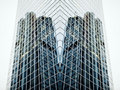 Futuristic building with overlayed perspective wide angle view of a glass high rise skyscrapers in modern Royalty Free Stock Photo