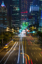 Futuristic cityscape at night in taipei with lit buildings and light trails of traffic taiwan Royalty Free Stock Image