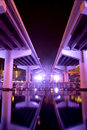 A futuristic looking illuminated expressway under the crosstown in tampa lit up purple at night giving it look Stock Photos