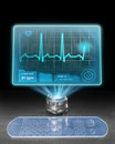 Futuristic medical computer with holographic screen displaying ecg Royalty Free Stock Photo