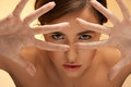 Futuristic woman face looking through fingers Royalty Free Stock Photo