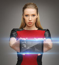 Futuristic woman with tablet pc Stock Images