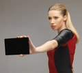 Futuristic woman with tablet pc bright picture of Stock Image