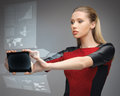 Futuristic woman with tablet pc bright picture of Royalty Free Stock Photo