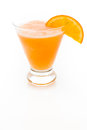 Fuzzy naval cocktail with orange wedge as a garnish Stock Photos
