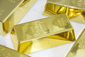 G gold bars on marble background Stock Images