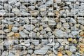 Stones in steel wire cage - gabion rock wall Royalty Free Stock Photo