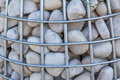 Gabion with a stone for planting ornamental plants close-up. The concept of landscape design Royalty Free Stock Photo