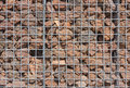 Gabion wall filled with lava stones in the sunlight Stock Photos