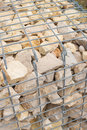 Gabion wall retaining with stacked riprap Stock Images
