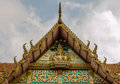 Gable apex of phechsamud temple in samudsongkham thailand with the statue of the lord buddha and panchawakhi Royalty Free Stock Photography