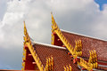 Gable apex thai temple with cloudy sky Royalty Free Stock Photos