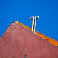 Gable of a mediterranean house with curious chimney Stock Images