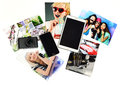Gadgets with printed photos camera tablet telephone and on white background Royalty Free Stock Photography