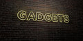 GADGETS -Realistic Neon Sign on Brick Wall background - 3D rendered royalty free stock image