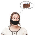 Gagged plus size woman dreaming about cake Royalty Free Stock Photo