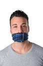 Gagged young man cannot speak with gag over his mouth is silenced and Royalty Free Stock Images