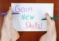 Gain new skills writing by both feet Stock Photos