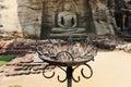 Gal viharaya buddha statues in polonnaruwa sri lanka burning incense sticks front of the sanctuary Royalty Free Stock Photos