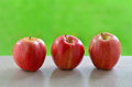 Gala apples delicious on windowsill with vibrant green background Royalty Free Stock Photography
