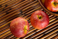 Gala apples red royal on placemat Royalty Free Stock Photo