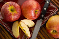 Gala apples red royal on a plate with a knife Royalty Free Stock Photo